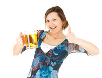 Pretty girl with thumb up drinking beer Stock Photos