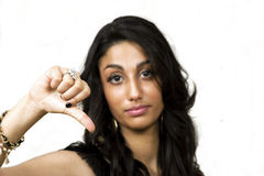 Pretty girl thumbs down handsign Royalty Free Stock Images