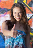 Pretty Girl with Thumbs Up Stock Photography