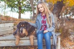 Pretty girl with tibetan mastiff on the nature Stock Photos