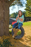 Pretty Girl on Tire Swing Royalty Free Stock Images