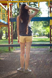 Pretty girl to climbing frame in park Royalty Free Stock Image