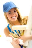 Pretty girl and  tools. Beautiful women and painting tools smiling Stock Images