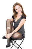 Pretty girl in the torn stockings. Sits on a chair royalty free stock photos