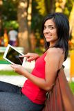 Pretty girl with touchscreen tablet Royalty Free Stock Image