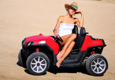 Pretty girl in toy car Stock Images