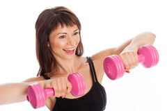 Pretty Girl Training With Weights Royalty Free Stock Images