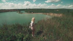 Pretty girl traveling with backpack and make photo of landscape with phone. Pretty girl traveling with backpack in shorts and make photo of landscape with phone stock video