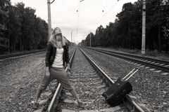 Pretty girl travels by railroad Stock Images