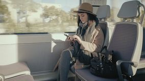 Pretty girl travels in train stock video footage