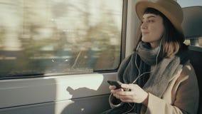 Pretty girl travels in train stock video