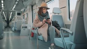 Pretty girl travels in train stock footage