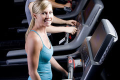 Pretty girl on a treadmill Royalty Free Stock Photos
