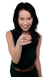 Pretty girl in trendy wear pointing you out Stock Photo