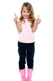 Pretty girl in trendy wear showing double thumbs up Royalty Free Stock Photography