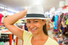Pretty girl tries on a white hat Royalty Free Stock Photography