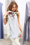 Pretty girl trying. On clothes Royalty Free Stock Images