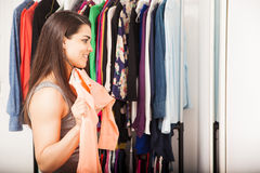 Pretty girl trying out some clothes royalty free stock photography