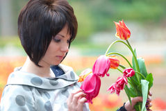 Pretty girl with tulips Stock Photography