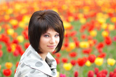 Pretty girl with tulips Royalty Free Stock Photo