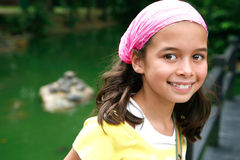Pretty girl by the turtle pond Stock Photo