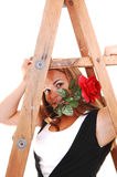Pretty girl under the stepladder. Royalty Free Stock Image