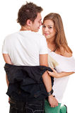 Pretty girl undressing her boyfriend Royalty Free Stock Image