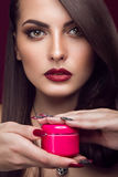 Pretty girl, unusual hairstyle, bright makeup, red Stock Photography