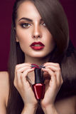 Pretty girl, unusual hairstyle, bright makeup, red Royalty Free Stock Photography
