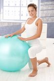 Pretty girl using fitball at home. Stock Photo