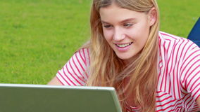 Pretty girl using her laptop stock footage