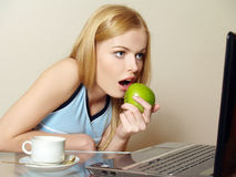 Pretty girl using a laptop Royalty Free Stock Images