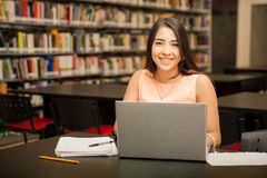 Pretty girl using a laptop computer Stock Images