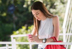 Pretty girl using mobile phone Royalty Free Stock Photos