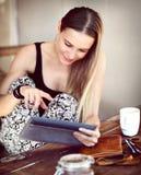 Pretty girl using tablet Stock Photo