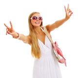 Pretty girl on vacation showing V sign Stock Photo