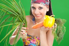 Pretty girl with vegetables Stock Images