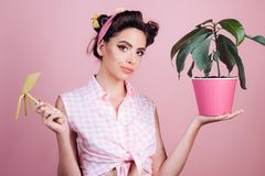 Gardening is more than hobby. pretty girl in vintage style. pin up woman with trendy makeup. pinup girl with fashion royalty free stock images