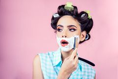 Pretty girl in vintage style. pinup girl with fashion hair. morning grooming and skincare. pin up woman with trendy. Makeup. retro woman shaving with foam and stock photos