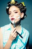 Pretty girl in vintage style. pinup girl with fashion hair. morning grooming and skincare. pin up woman with trendy. Makeup. retro woman shaving with foam and stock photo