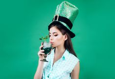 Pretty girl in vintage style. retro woman drink summer cocktail. St. Patricks Day pin up woman with trendy makeup. pinup. Girl with fashion hair. Let the party stock images