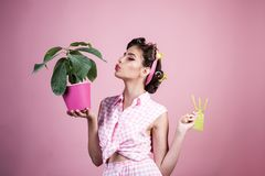 Pretty girl in vintage style. retro woman growing plants. Garden. pin up woman with trendy makeup. pinup girl with. Fashion hair. greenhouse worker or gardener stock photography