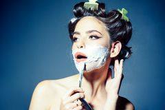 Pretty girl in vintage style. woman shaving with foam and razor blade. pin up woman with trendy makeup. pinup girl with. Fashion hair. morning grooming and royalty free stock photos