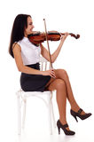 pretty girl with violin at chair Stock Photos