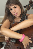 Pretty girl with violoncello Stock Images