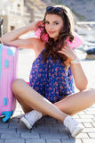Pretty girl waiting for cruise near suitcase Royalty Free Stock Photo
