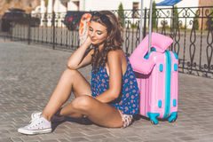 Pretty girl waiting for cruise near suitcase Stock Images