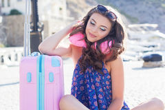 Pretty girl waiting for cruise with neck pillow Stock Photography