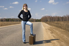 Pretty girl waiting on the road royalty free stock photos