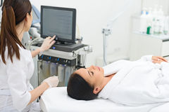 Pretty girl waiting for ultrasound facial treatment Royalty Free Stock Photography
